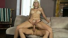 Slutty blonde teacher wraps her tight pussy around his young raging boner