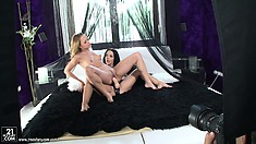 Blue Angel and Angelina Wild prepare themselves for a hot lesbian sex scene