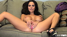 Busty babe Ava Addams plays with her tits and fingers her twat