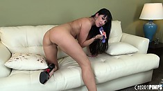 Eva Karera sticks thick sex toy into her cleanly shaved beaver