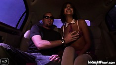 In the back seat of the car, Lyla has a guy playing with her nipples and with her pussy