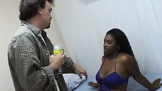 In the shower, a busty black girl washes her curvy body and shaves her hairy cunt