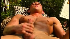 Muscled guy exposes his hot body and strokes his big dick to orgasm