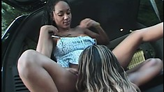 Lusty ebony tart gets her wet clit worked in the back of a van