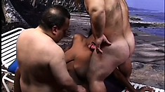 Busty black chick gets surprised by two midgets with big cocks