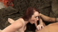 Gorgeous redhead gets to work on a lucky man's pulsing boner