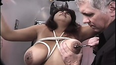 Sexy chick with an awesome rack enjoys some freaky bondage fun