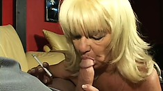 Naughty blonde granny uses her gums to milk a young dick dry