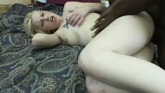 Pretty white tramp is eager and willing to test out some darker dick