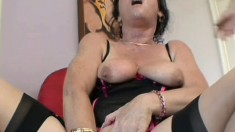 Slutty mature lady with big tits has two guys fucking her holes at once