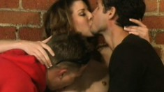 Attractive brunette Lisa Marie gets fucked by two guys in the warehouse