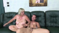 Lustful mature blonde with big tits madly sucks and fucks a young stud's long dick