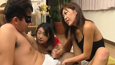 Three naughty Asian girls fight over a masked man's bulging prick