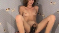 Luscious Monica has a big black dildo making her pussy wet and happy