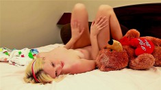 Tatyana plays with her teddy bear before she fucks herself with a dildo