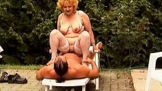 Busty mature Lisa eats his dick outside and fucks on the lounger