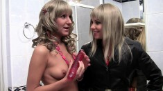 Blonde babe can't get enough of playing with a sexy bombshell