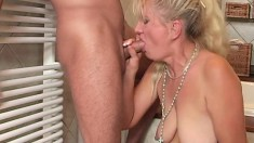 Desirable blonde mommy has a young boy's shaft making her twat happy