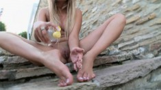 Gorgeous Donna oils up her sexy feet and gently caresses her wet peach