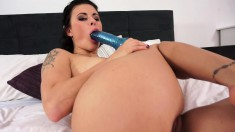 Billie has a massive blue dildo and isn't afraid to use it for you