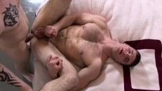 Ivan James and Colby Foust feed their lust for anal action on the bed