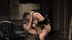Lustful gay lovers with muscled bodies feed their desire for anal sex