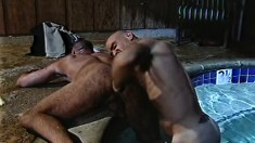 Two muscular hunks start with foreplay in the pool and end with anal sex in bed