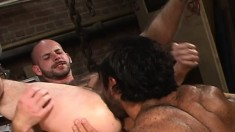 Handsome young buck bends over and feels a fist in his asshole