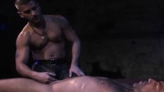 Bound hairy stud gets his cock stroked and sounded by a muscled bear