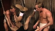 Submissive boy has two hunky gay studs taking turns pounding his ass