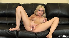 The marvelous blonde lies comfortably on the couch relishing the wild masturbation