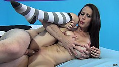 Mckenzie Lee lies on the bed and has him filling her tight pussy with his big shaft