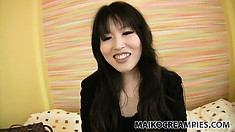 Kazue, a beautiful Asian babe with a pretty smile, is eager to satisfy her sexual urges