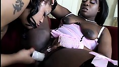 Naughty ebony lesbians put their dildos to work on each other