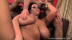 Brunette MILF with huge hooters gives a rimjob and gets prodded