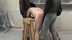 All tied up, the kinky guy takes a cock up his ass and another down this throat