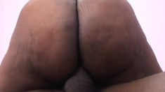 Dark skinned lady with a big booty has a black stud drilling her peach