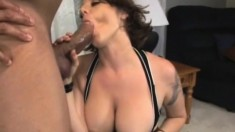 Busty beauty Kayla straddles a well hung dude and rides him well