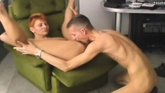 Hot redhead milf has a young man banging her twat the way she loves it