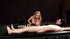 Playful blonde dominatrix enjoys using a vibrator to massage this cock