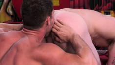 Tattooed hunk can't get enough of a large dick exploring his tight ass