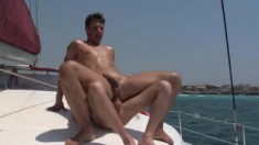 Two irresistible gay friends making the most of their time on a boat