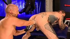 Tattooed gay stud welcomes his friend's fist deep inside his fiery ass