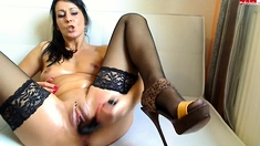 Brunette milf in stockings masturbating by dildo on webcam