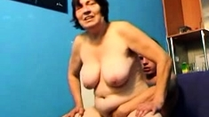 Mature granny milking thick young cock in laundry