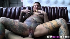 Big-tits granny covered in tattoos doing anal
